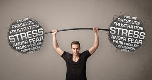 Muscular man fighting with stress Stock Photography