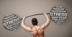 Muscular man fighting with stress Royalty Free Stock Photo