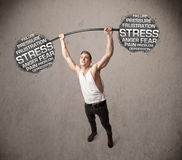 Muscular man fighting with stress Stock Photos