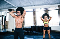 Muscular man and fit woman workout at gym Royalty Free Stock Photography