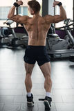 Muscular Man Flexing Back Muscles In Gym Royalty Free Stock Images