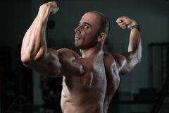 Muscular Man Flexing Back Muscles Pose Royalty Free Stock Image