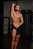 Muscular Man Flexing Muscles In Gym Stock Images