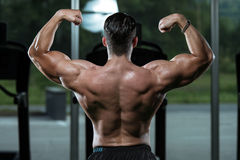 Muscular Man Flexing Muscles Stock Photo