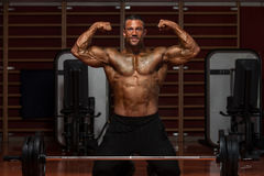 Muscular Man Flexing Muscles Stock Images