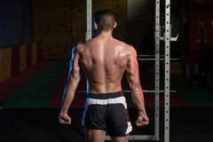 Muscular Man Flexing Muscles Side Triceps Pose Royalty Free Stock Photo