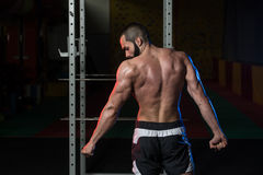 Muscular Man Flexing Muscles Side Triceps Pose Stock Image