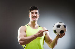 Muscular man with football ball Royalty Free Stock Photo