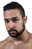 Muscular man frowning at camera Stock Photos