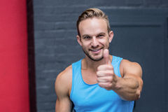 Muscular man gesturing thumb up Royalty Free Stock Photography