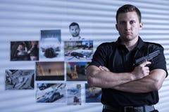 Muscular man with gun Stock Photos