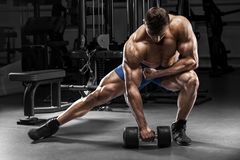 Muscular man in gym, bodybuilder. Strong male naked torso, working out Royalty Free Stock Image