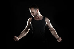 Muscular man,  hand, pumped up muscles, black background Stock Image