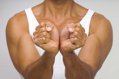 Muscular man with hands together. Showing strength stock photos