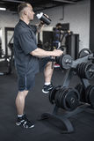 Muscular man has pause in gym Royalty Free Stock Photo