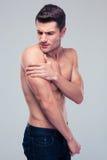 Muscular man having shoulder pain Royalty Free Stock Image