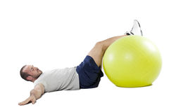 Muscular man with healthy ball doing exercises Stock Photography
