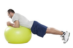 Muscular man with healthy ball doing exercises Royalty Free Stock Image