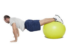 Muscular man with healthy ball doing exercises Royalty Free Stock Photos