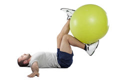 Muscular man with healthy ball doing exercises Stock Photos