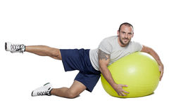 Muscular man with healthy ball doing exercises Royalty Free Stock Photo