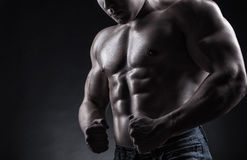 Muscular man. Healthy muscular young man on a dark background Stock Photo
