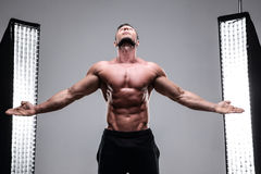 Muscular man with his hands in the air at his sides Royalty Free Stock Photo