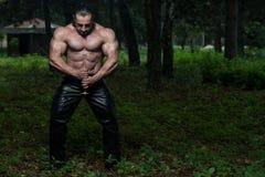 Muscular Man Holding Ancient Sword Stock Photos