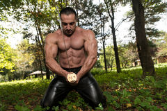 Muscular Man Holding Ancient Sword Stock Images