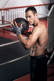 Muscular man holding fitness ball Royalty Free Stock Images