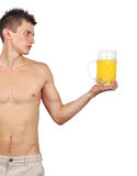 Muscular man holding a glass of juice Royalty Free Stock Image