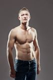 Muscular man holding hands on waist Stock Image