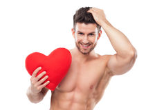 Muscular man holding heart shape Stock Photography