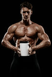 Muscular man holding jar with protein Royalty Free Stock Photo