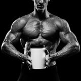 Muscular man holding jar with protein Stock Photo