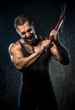 Muscular man holding pickaxe Stock Image