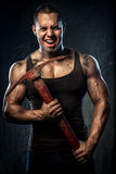 Muscular man holding pickaxe Royalty Free Stock Images