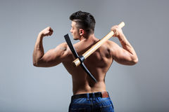 Muscular man holding pickaxe Royalty Free Stock Photography