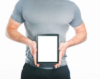 Muscular man holding tablet  isolated on white background Stock Images