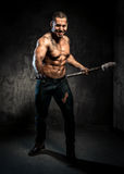 Muscular man holding torch Royalty Free Stock Photos