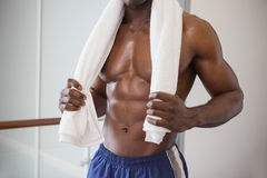 Muscular man holding towel around neck Stock Images