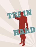 Muscular man holding train hard words. Vector silhouette Royalty Free Stock Image
