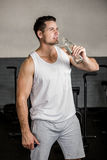 Muscular man holding water bottle Stock Photography