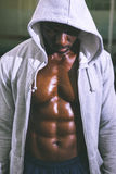 Muscular man in hood jacket Royalty Free Stock Images