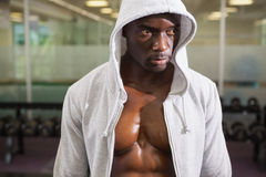 Muscular man in hood jacket Stock Images