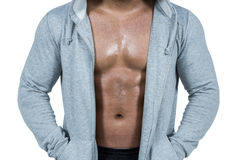 Muscular man in hooded jumper Stock Image