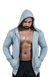 Muscular man in hooded jumper Royalty Free Stock Images