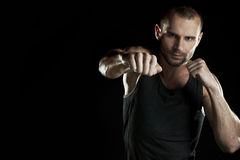 Muscular man, hour boxer, black background Stock Photography