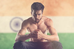 Muscular man with India Flag behind. Muscular man Stock Photo