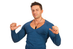 Muscular man indicate to him Stock Photography